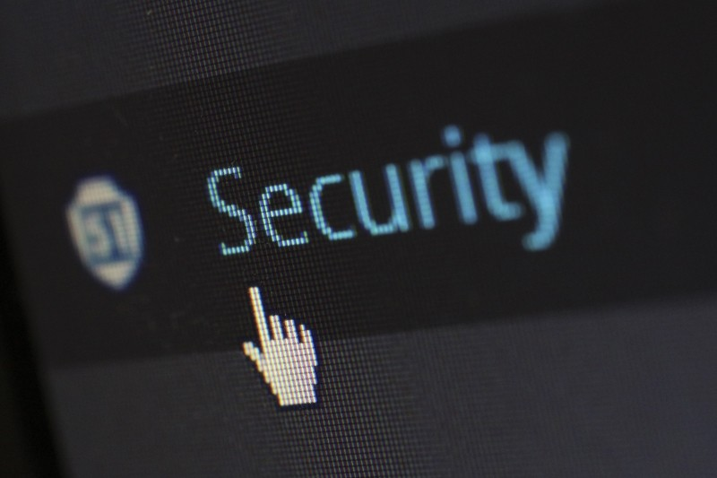 Imagem do ícone do mouse de computador passando em cima da palavra Security